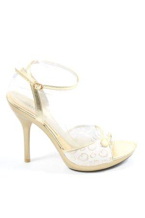 Guess by Marciano High Heel Sandaletten goldfarben-weiß Schriftzug gedruckt