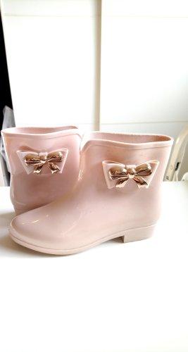 Botas de agua color oro-rosa