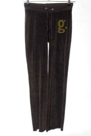 gwynedds Pantalón deportivo negro-color oro estampado temático look casual