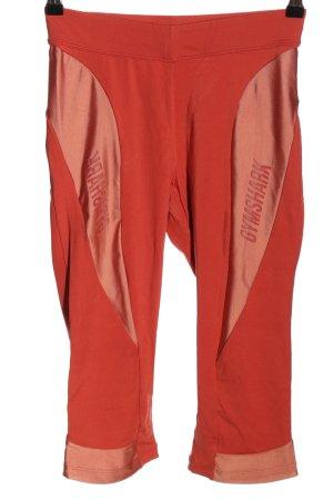 GYMSHARK Sportbroek licht Oranje gedrukte letters atletische stijl