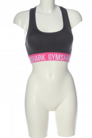 GYMSHARK Top deportivo sin mangas negro-rosa letras impresas look casual