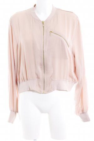 H&M Blusón color oro-rosa look casual