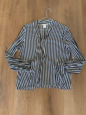 H&M Blusa con lazo negro-blanco puro