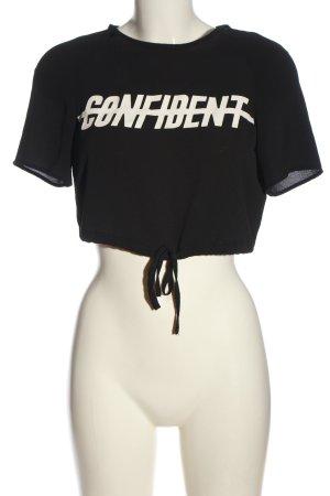 H&M Divided Camisa recortada negro-blanco letras impresas look casual