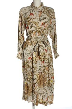 H&M Vestido tipo blusón estampado repetido sobre toda la superficie elegante