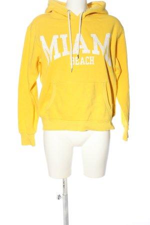 H&M L.O.G.G. Kapuzensweatshirt blassgelb-weiß Schriftzug gedruckt Casual-Look