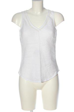 H&M Blusa de lino blanco look casual