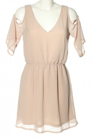 H&M Mini vestido crema look casual