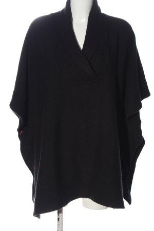 H&M Poncho negro estampado a rayas look casual