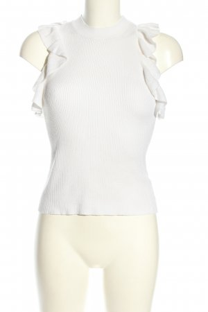 H&M Top de volantes blanco look casual