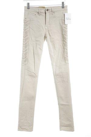 H&M Skinny Jeans beige-graubraun Logo-Applikation aus Leder