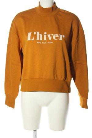 H&M Sweatshirt hellorange Schriftzug gedruckt Casual-Look