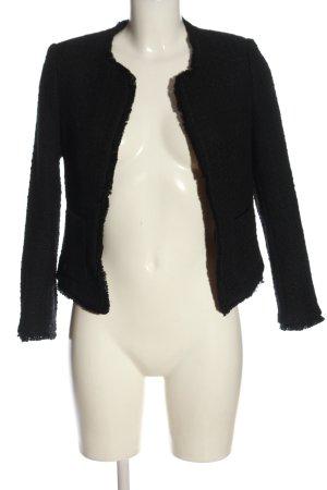H&M Blazer in tweed nero modello web stile professionale