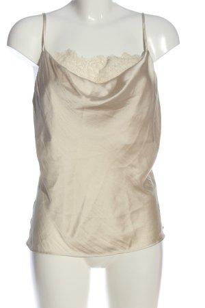 H&M Top tipo cascada crema look casual