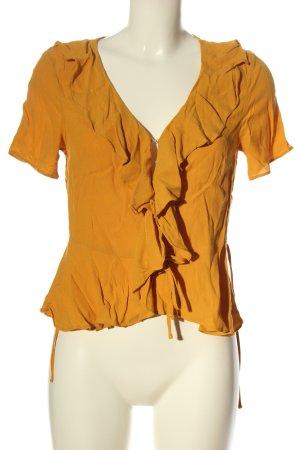 H&M Blusa cruzada naranja claro look casual