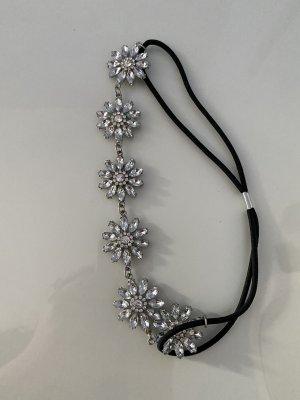 Haarband mit silbernen Blüten