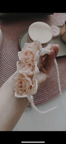 Bonnet à pompon or rose
