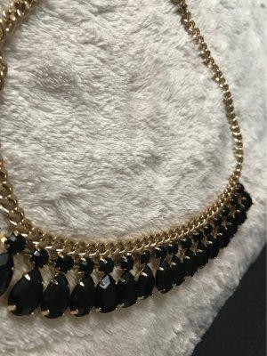 Collar color oro-negro
