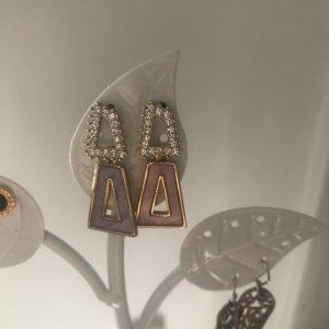 Boucle d'oreille incrustée de pierres or rose-doré