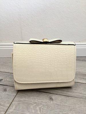 Handtasche in Reptiloptik