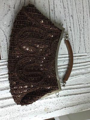 Bolso con correa color bronce-marrón