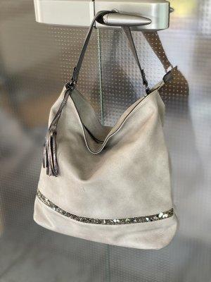 Handtasche mit  Zierleiste aus kleinen Steinchen
