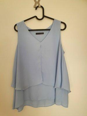 Hellblaue ärmellose Bluse