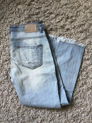 Hellblaue Boyfriend Jeans im Used Look
