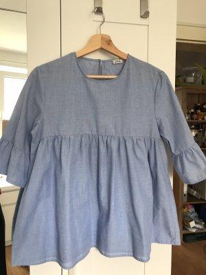 Hellblaue schöne Bluse