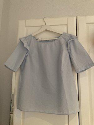 Hellblaues Blusenshirt mit Rüschendetails