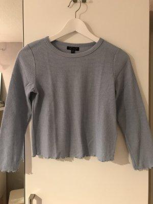Hellblaues Crop-Shirt mit Rollsaum