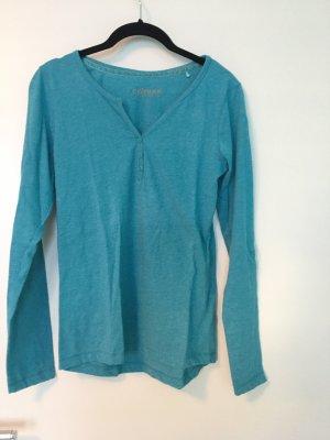 Hellblaues Shirt mit langen Ärmeln, V-Ausshnitt und Knöpfen