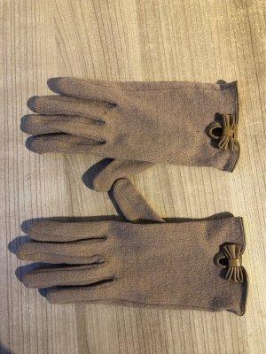 Hellbraune Handschuhe mit Schleife