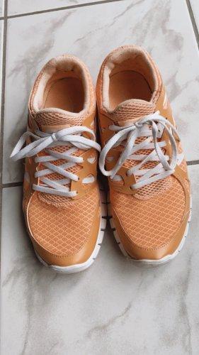 Hellorange Sneakers Nike Damen