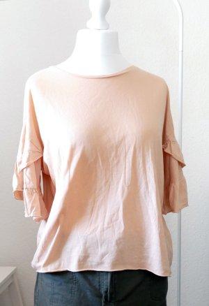 Hellrosa Shirt mit Rüschenärmeln