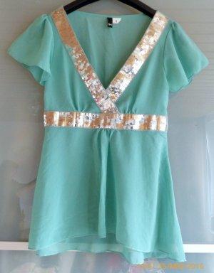 helltürkises H&M Shirt mit silber Pailetten am V-Ausschnitt und in der Taille