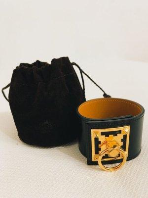 Hermès Ajorca negro-color oro Cuero