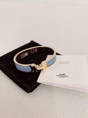 Hermès Ajorca azul celeste-color oro