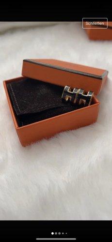 Hermès Zarcillo negro-color oro