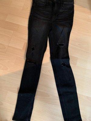 High waist jeans mit Löchern
