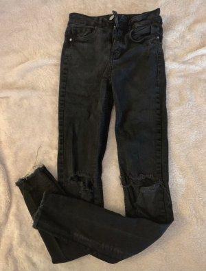 High-Waist Jeans mit Löchern