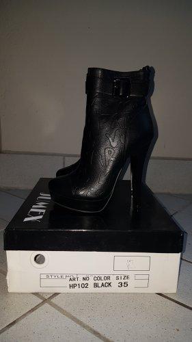 Bottines à plateforme noir faux cuir