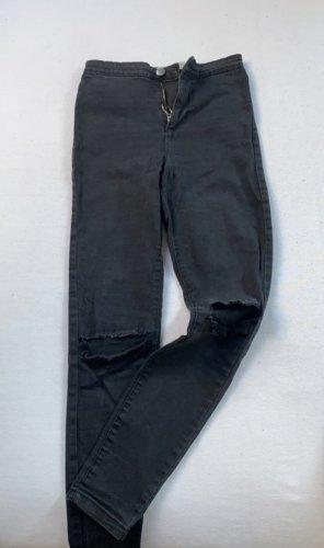 Highwaist Jeans mit Loch im Knie