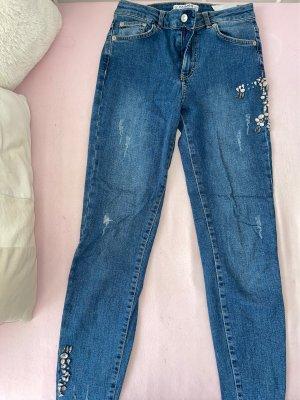 Highwaist Skinny Jeans mit Details