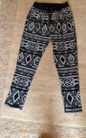 H&M Luźne spodnie w kolorze białej wełny-czarny