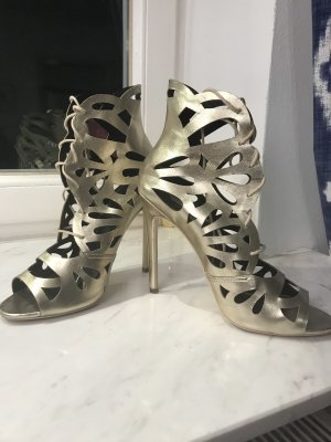 High-Front Pumps gold-colored