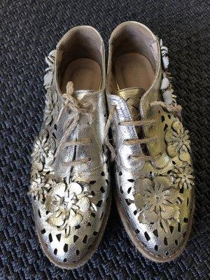 Hochwertige Sneaker von Aquamarine in Gold