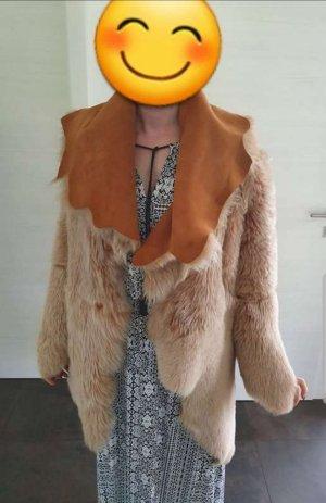 Manteau de fourrure marron clair