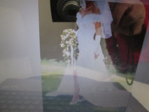 Hochzeitskleid knielang mit abnehmbarer Schleppe und Schleier