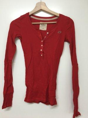 Hollister / geripptes Langarmshirt mit Knopfleiste in knalligem Rot